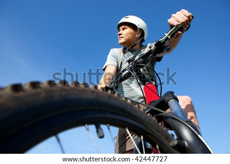 Men on mountain bike. - stock photo