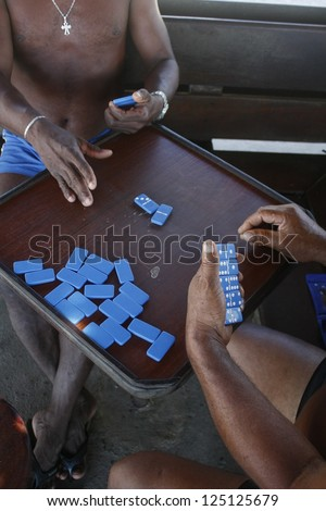 Men play dominoes in Brasil - stock photo