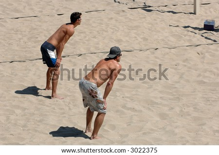 Men Playing Beach Volleyball in Southern California - stock photo