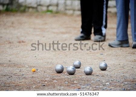 Men playing boules in park.