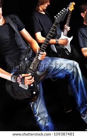 Men playing  guitar in night club. - stock photo