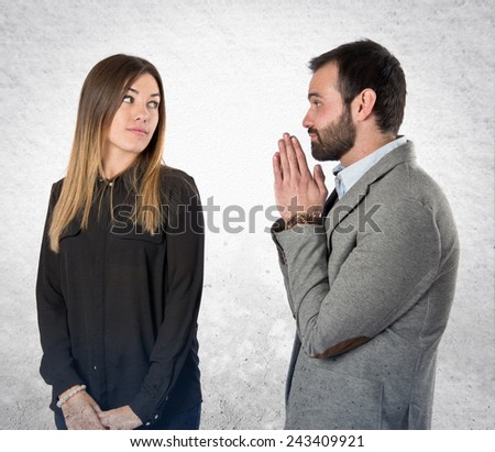 Men pleading at his girlfriend over white background  - stock photo