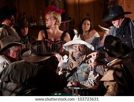 Men point guns at elderly gambler set up by woman - stock photo