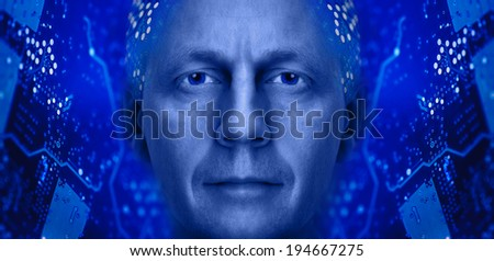 Men portrait on a electronic circuit board background. Toned blue. - stock photo