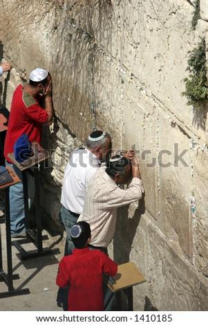 Men Pray at the Wailing Wall Jerusalem,Israel - stock photo