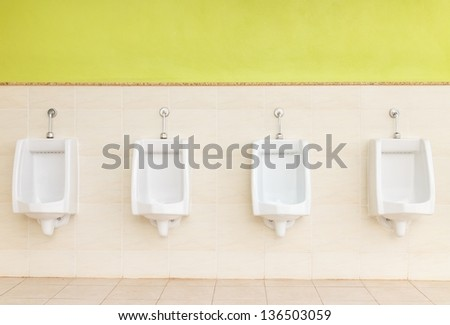 Men public toilet - stock photo