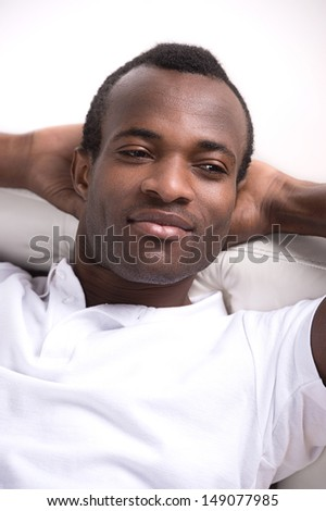 Men relaxing. Relaxed African descent men holding his head in hands and looking away