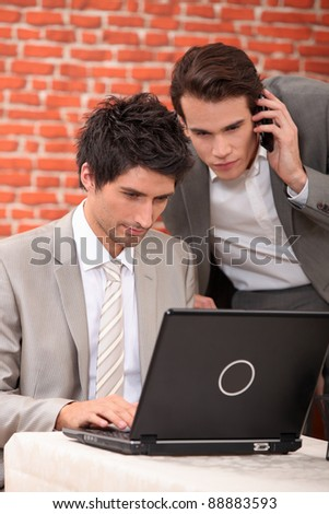 Men resolving a problem on computer - stock photo