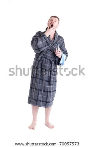Men's bath robe on white background with toothbrush - stock photo