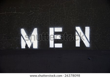 Men's bathroom door sign, spray painted stencil letters - stock photo