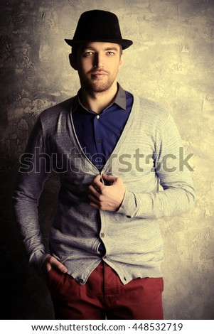 Men's beauty, fashion. Elegant good looking young man in a hat. - stock photo