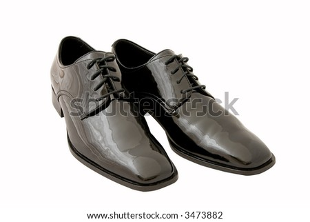Men's black dress / tuxedo shoes on white background. Clipping path included.