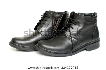 Men's black leather boots on a white background
