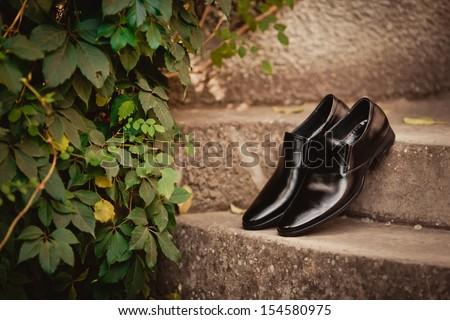 Men's black leather dress shoes - stock photo
