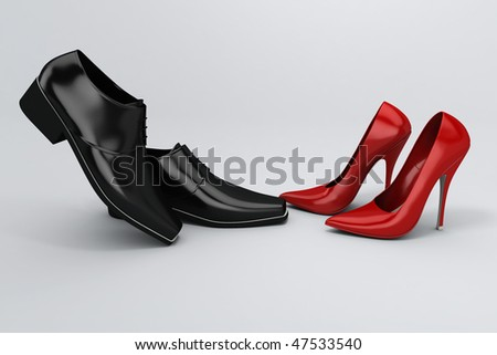 Men's black shoes and women's red shoes on grey background - stock photo