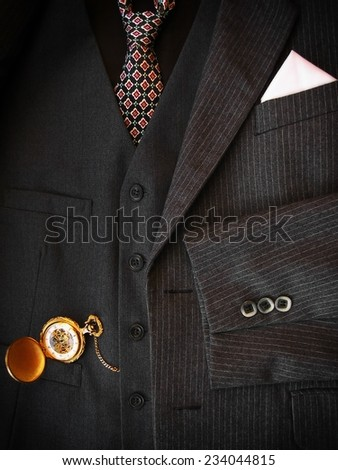 Men's black suit with golden pocket watch. - stock photo