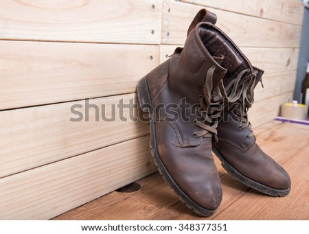 Men's boot fashion on wooden floor