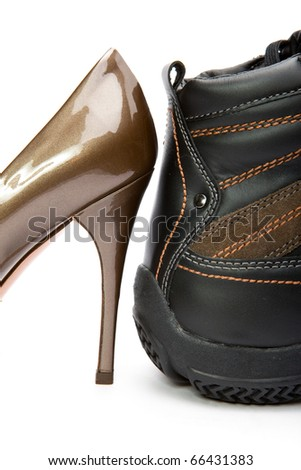 Men's boots and elegant female shoes on white background