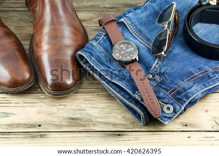 Men's casual outfits on wooden background