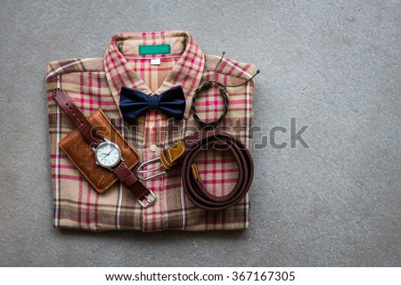 Men's casual outfits with accessories on gray background - stock photo