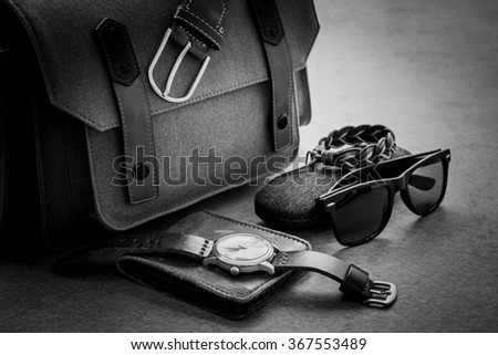 Men's casual outfits with camera bag and accessories on gray grunge background - stock photo