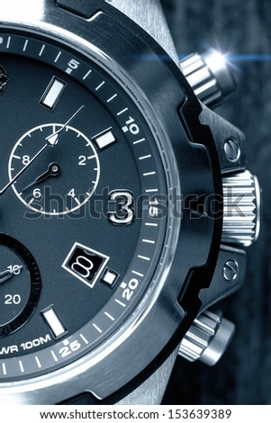 Men's chunky watch close up in black and white - stock photo