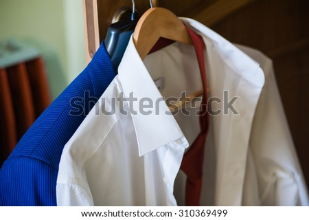 men's clothing on a hanger before wedding ceremony - stock photo