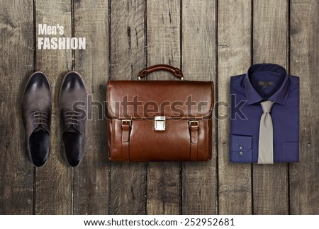 men's clothing worn wooden background - stock photo