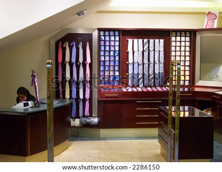 Men's colorful ties on display. Shopping. - stock photo