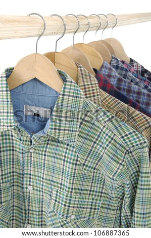 Men's different sleeved plaid cotton on a wooden hanger - stock photo