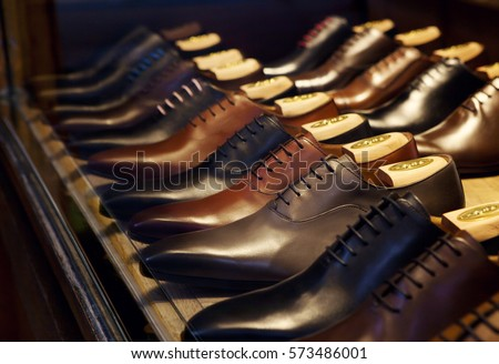 Men's fashion leather shoes on a shop window