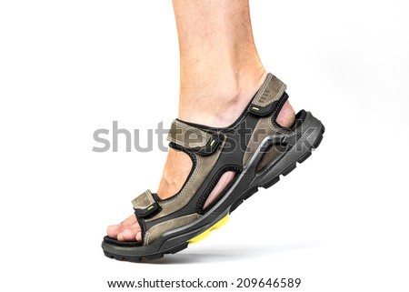 Men's foot in sandals on a white background - stock photo