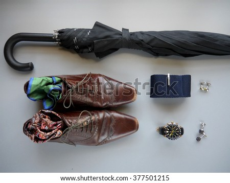 Men's formal fashion accessories: tie, watch, shoes, umbrella, cuff links and pocket squares  - stock photo