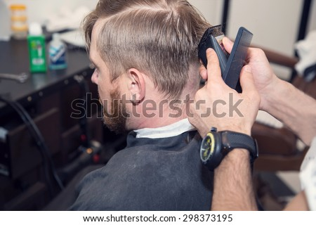 Master cuts hair men barbershop hairdresser stock photo for The barbershop a hair salon for men