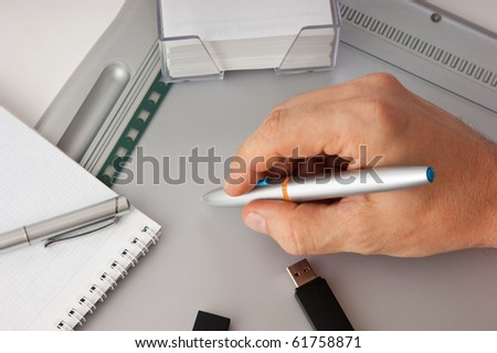 Men's hand draws on the graphic tablet