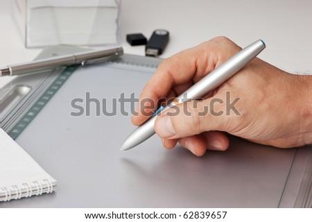 Men's hand draws tablet pc - stock photo