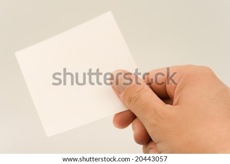 men's hand holding blank business card. Giving a note - stock photo