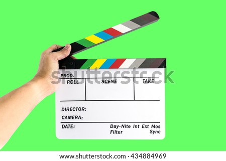 Men's hand holding camera slate  for the filming isolated on green background. - stock photo