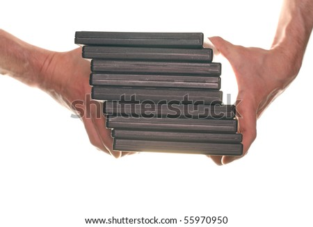 Men's hand holding many DVD CD discs on white background isolated - stock photo