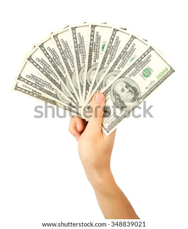 Men's hand holds a fan of dollars isolated on white background