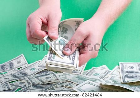 Men's hand recount money - stock photo