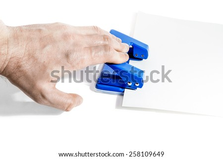 Men's hand stapler staples multiple sheets of paper isolated on white background - stock photo