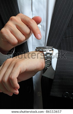 men's hand with a watch.
