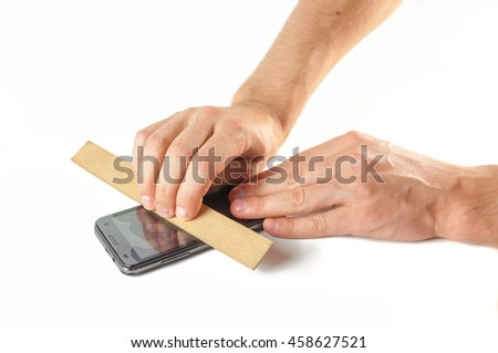 Men's hands are fixed on the phone screen protective film .