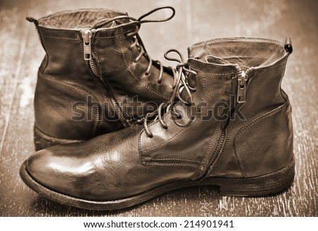 Men's leather fashion shoes. Autumn - spring shoes. Cowboy style. Vintage style. Photo toning in sepia - stock photo