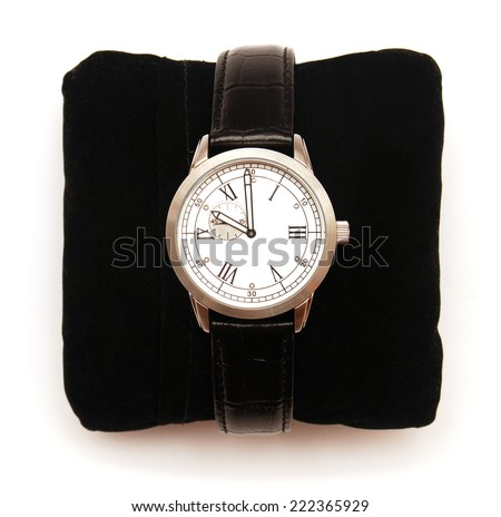 Men's mechanical classic watch on a pillow isolated on white background - stock photo