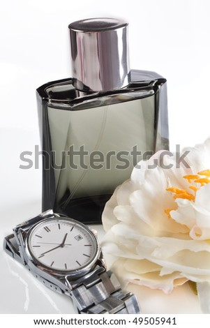 Men's perfume and watches - stock photo