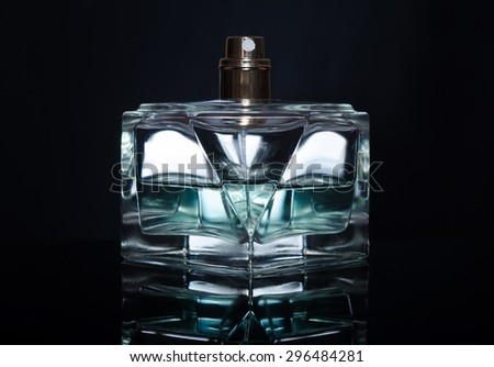 men's perfume bottle on a black background - stock photo