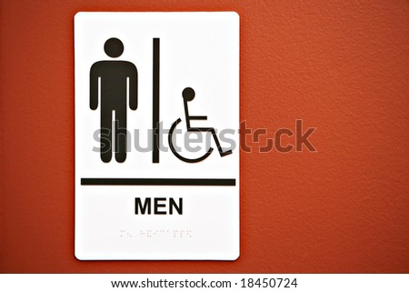 Men's Room Sign on on Orange Colored Wall
