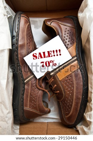 "Men's shoes in a box with the label ""70% SALE"""